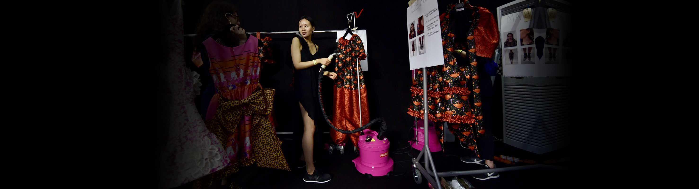 Lady using PRO580P Pink steamer backstage at London Fashion Week